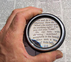 picture of magnifying glass over page of text